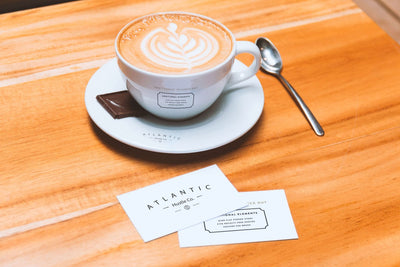 Business Cards and Coffee Cup on Table (Mockup)