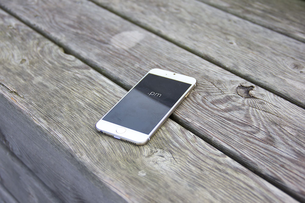White Iphone 6 On A Wooden Table Psd Mockup Mockup Hunt