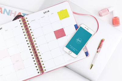 iPhone Mockup With A Calendar On A Table