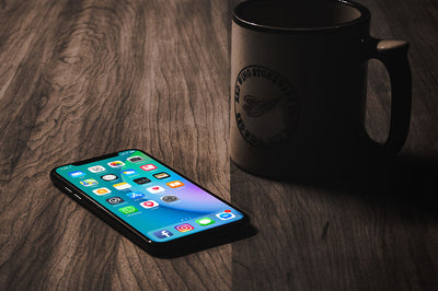 iPhone X with Coffee Mug Mockup