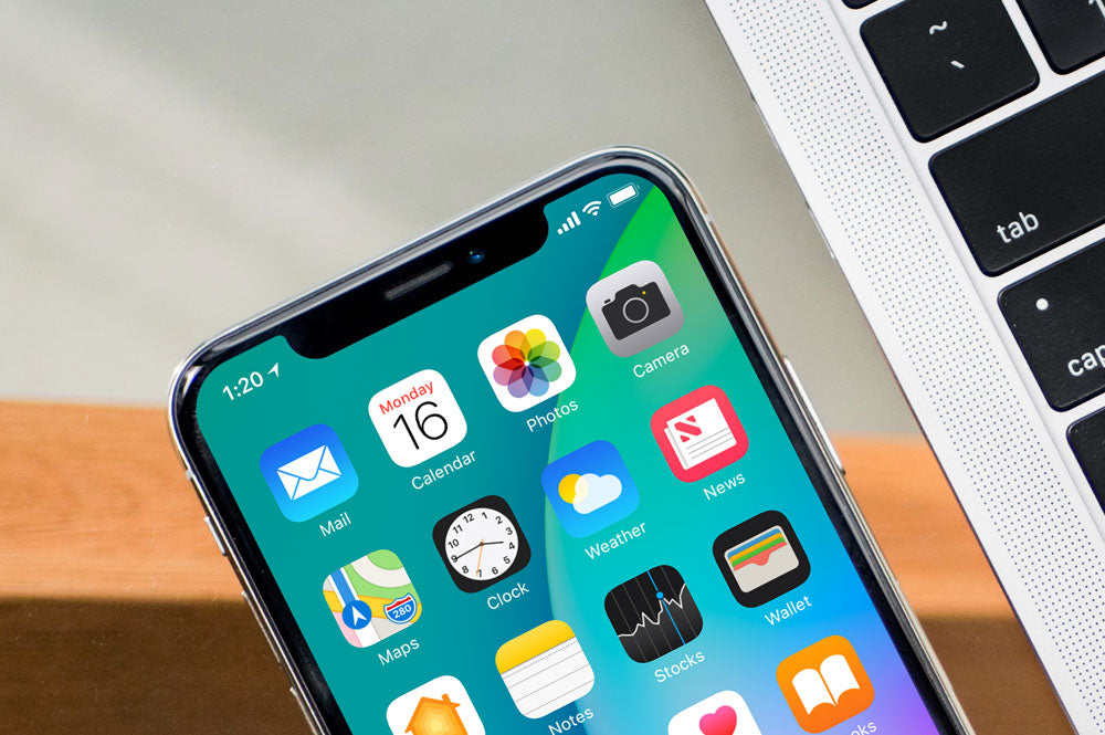 Black Iphone X On Glass Table With Macbook Pro Psd Mockup Mockup Hunt