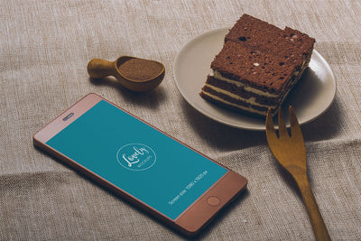 Smartphone and Tasty Cake on a Table