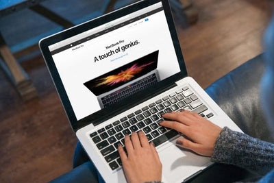Woman Typing Code on Macbook Pro Mockup