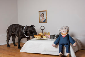 Theresa May dog toy enjoying afternoon tea with a dog
