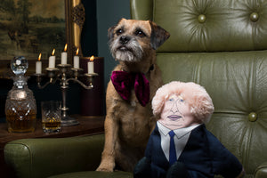 Boris Johnson dog toy sat in gentleman's club with dog