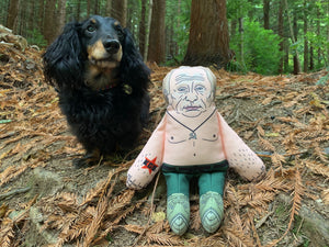 Vladimir Putin dog toy in woods with dog