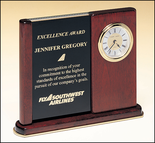 Airflyte Rosewood stained piano finish clock on a brass trimmed base