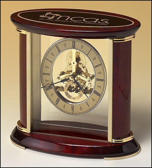 Airflyte Skeleton clock with sub-second dial, brass finished movement and rosewood piano finish accents