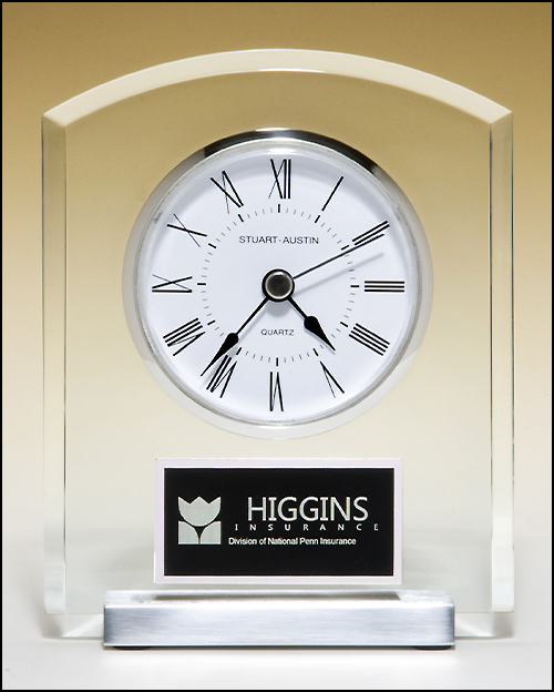 Airflyte Acrylic clock with polished silver aluminum base. Silver bezel, white dial, three-hand movement