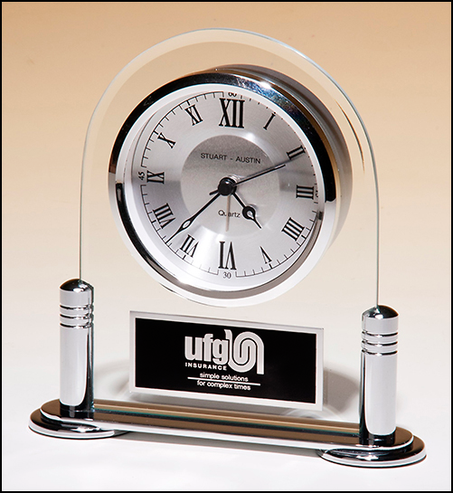 Airflyte Desk clock with beveled glass upright and silver metal base, three hand clock movement