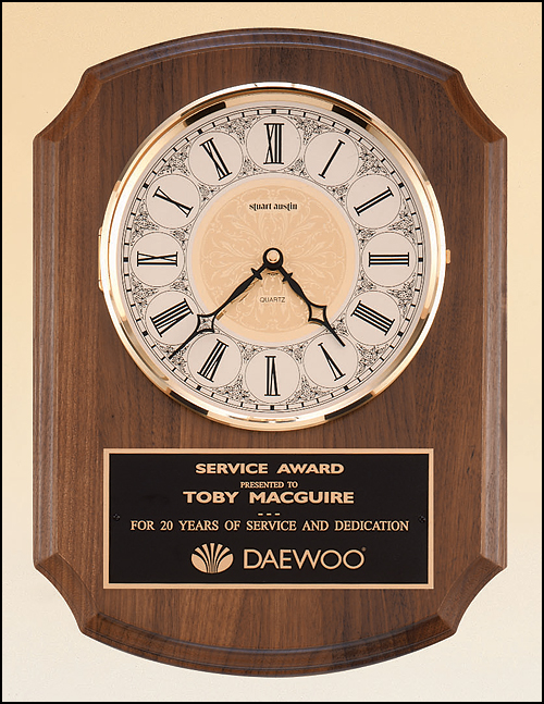 Airflyte American walnut vertical wall clock with Solid brass, diamond-spun bezel with glass lens, ivory dial and three hand movement