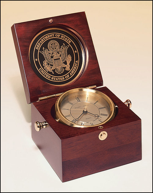Airflyte Captain's Clock with solid brass clock housing in a hand rubbed mahogany-finish case