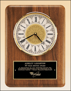 Airflyte American walnut vertical wall clock with Solid brass diamond-spun bezel with glass lens and ivory dial