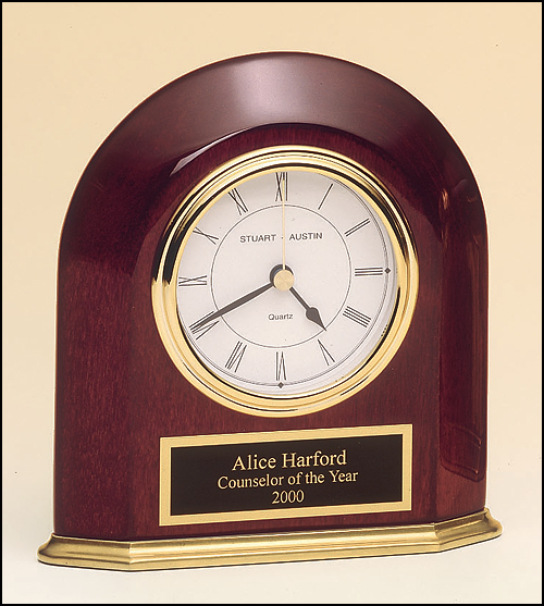 Airflyte Rosewood stained piano finish arched table clock with solid brass base and three hand movement
