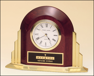 Airflyte Rosewood stained piano finish arched clock with solid brass base and sides with three hand movement