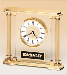 Airflyte Clock with glass upright, brass feet and top and metal goldtone columns