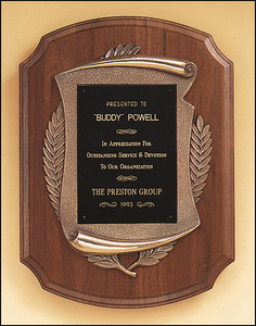 Airflyte Solid American cove step edge walnut plaque with an antique bronze scroll casting frame