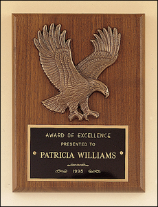Airflyte American walnut plaque with a sculptured relief Eagle casting