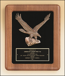 Airflyte American walnut frame with a sculptured relief Eagle casting on a black velour background