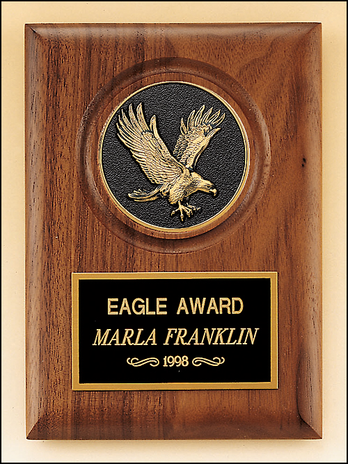 Airflyte American walnut plaque with a finely detailed black and gold Eagle medallion