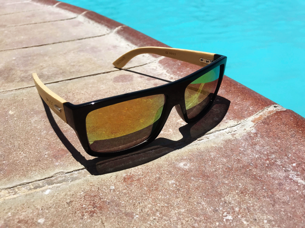 bamboo sunglasses in near swimming pool
