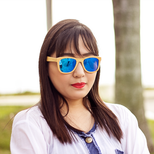blaker blue mirror lens bamboo sunglasses lifestyle photo women