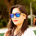 coniston blue mirror polarized lens bamboo sunglasses lifestyle photo for women