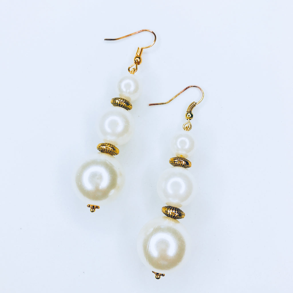 Joy - chic gold and white bead earrings.