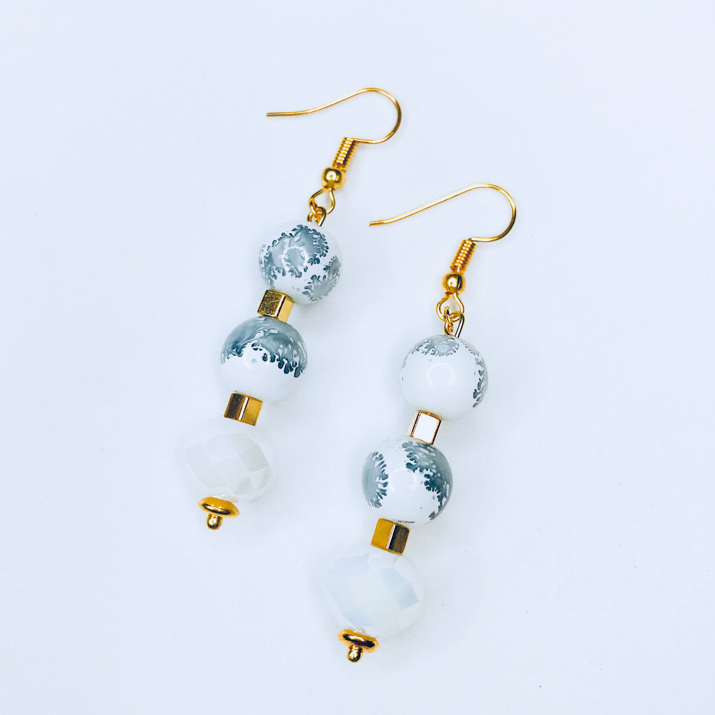 Jennifer - Long chic white beads with ink stamps earrings.