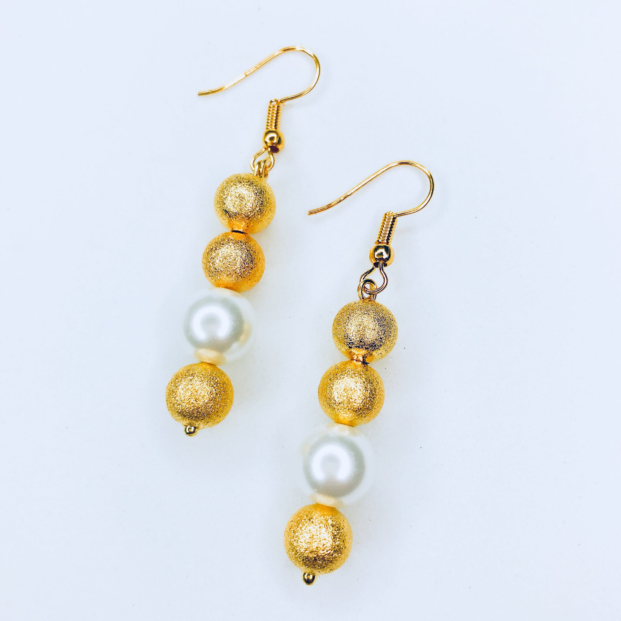 Janina - chic gold and white bead earrings.