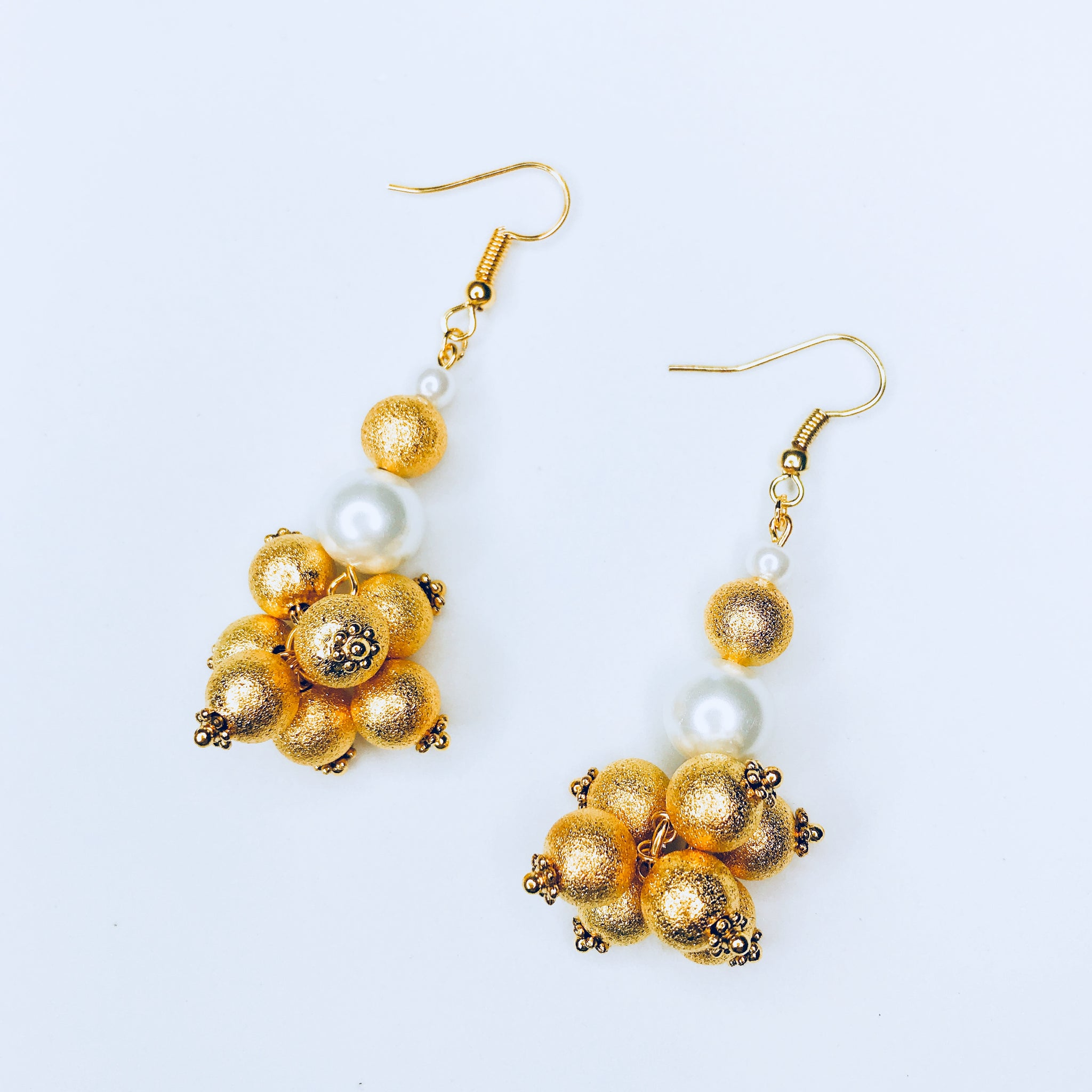 Julia - statement pearl and gold earrings.