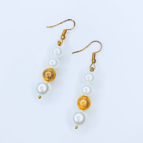 Joleen - chic gold and white bead earrings.