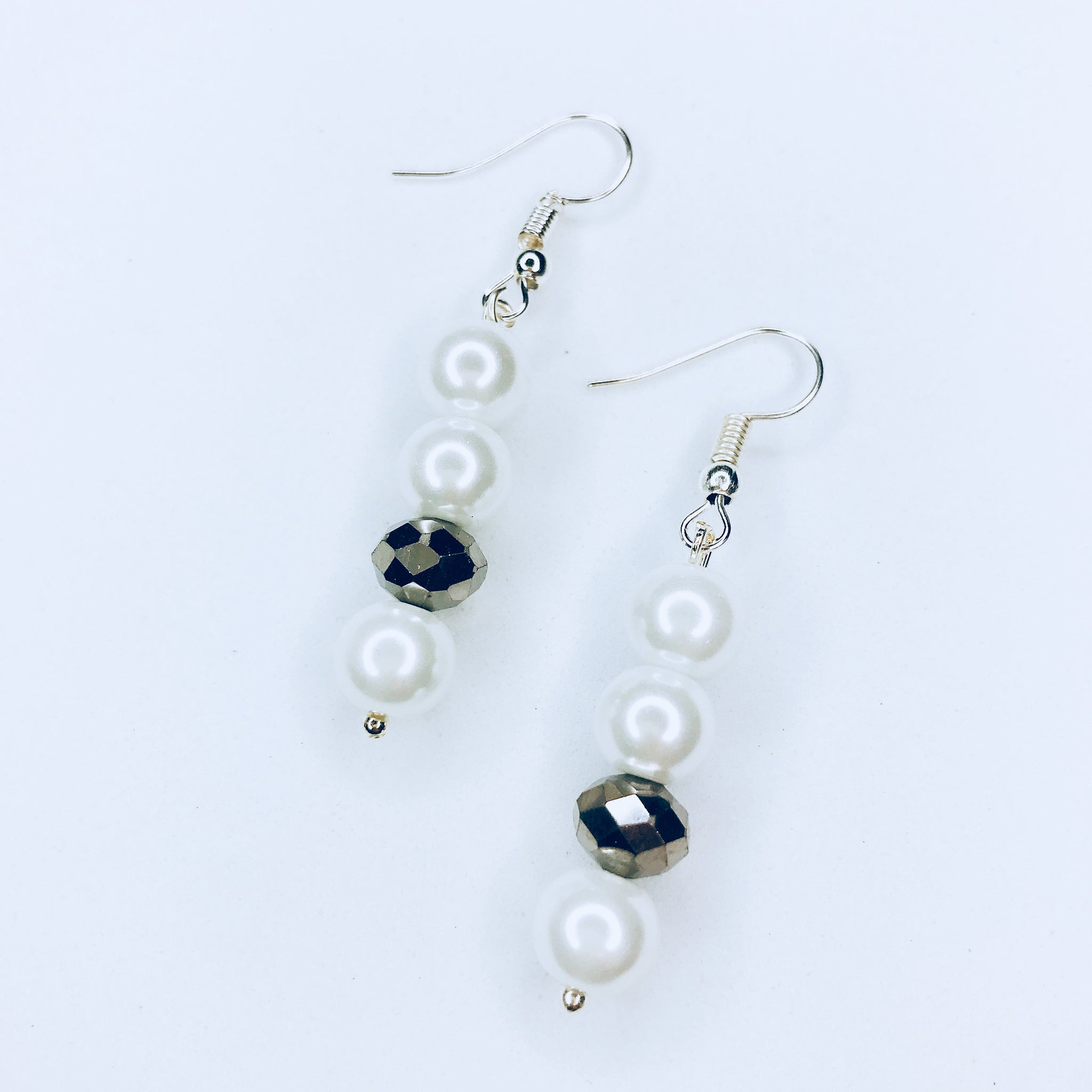 Joli - chic silver and white bead earrings.