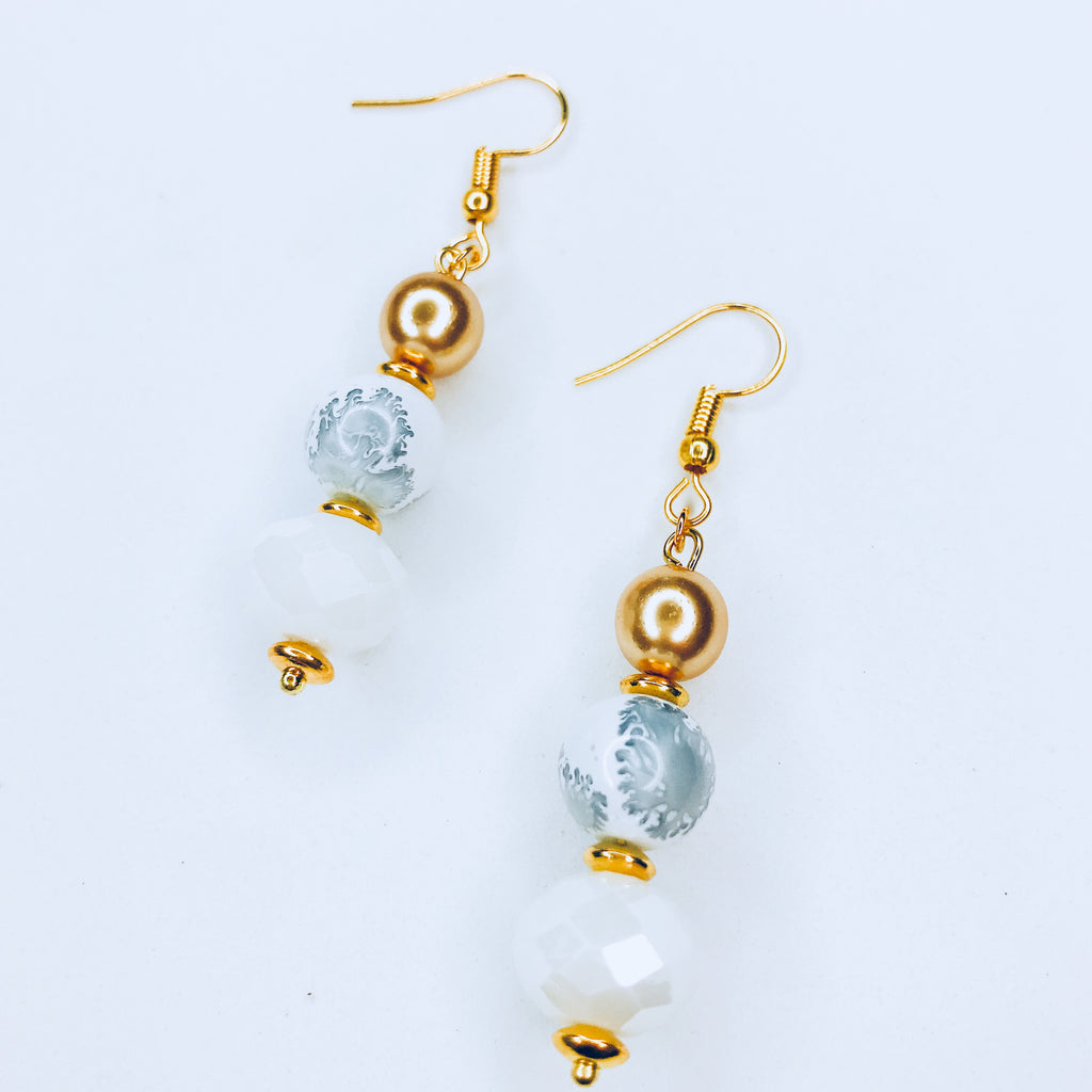 Jaci- Long chic white beads with ink stamps earrings.