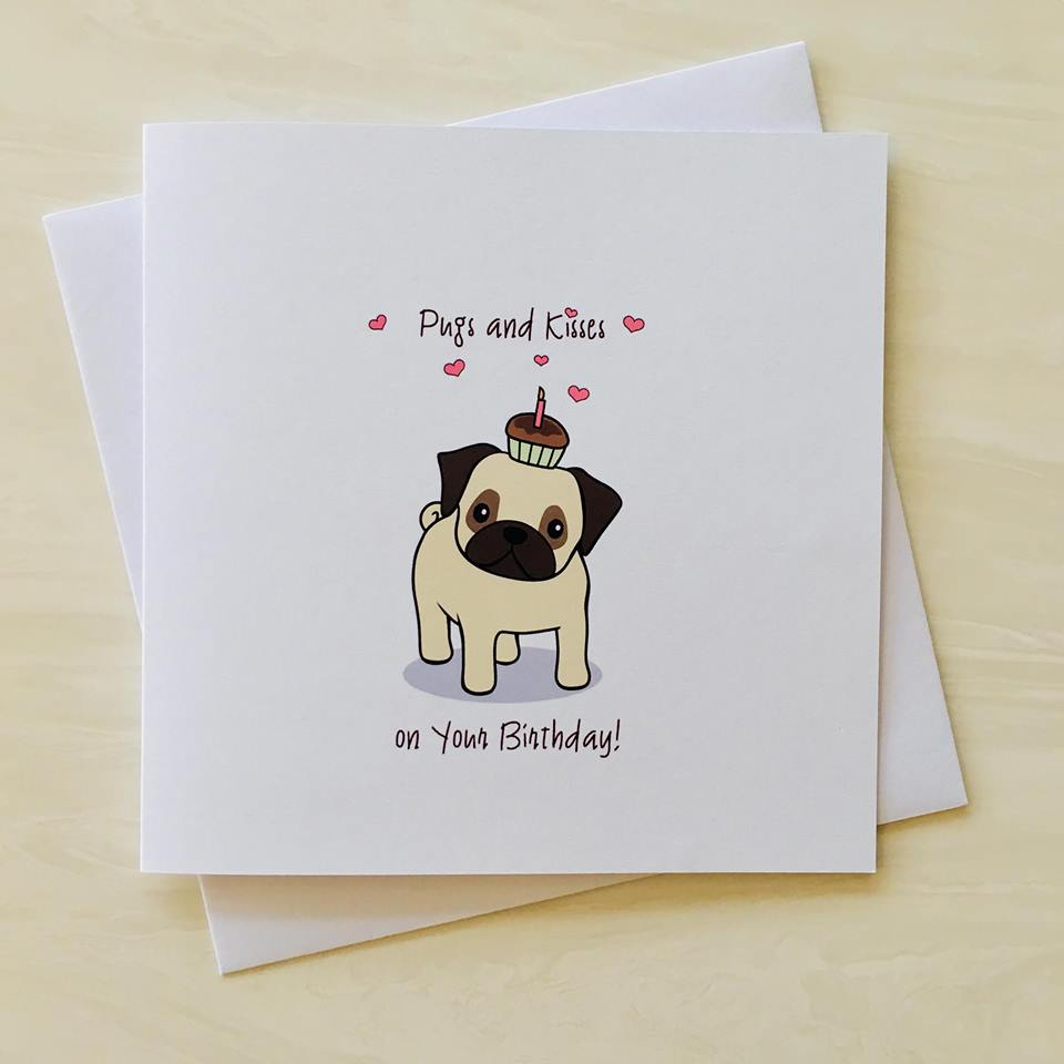 birthday card with cartoon image of a pug surrounded by hearts with message saying pugs and kisses on your birthday