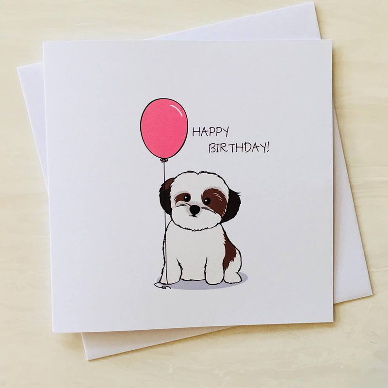 birthday card with cartoon image of a shih tzu dog holding a birthday balloon with message happy birthday on front of card