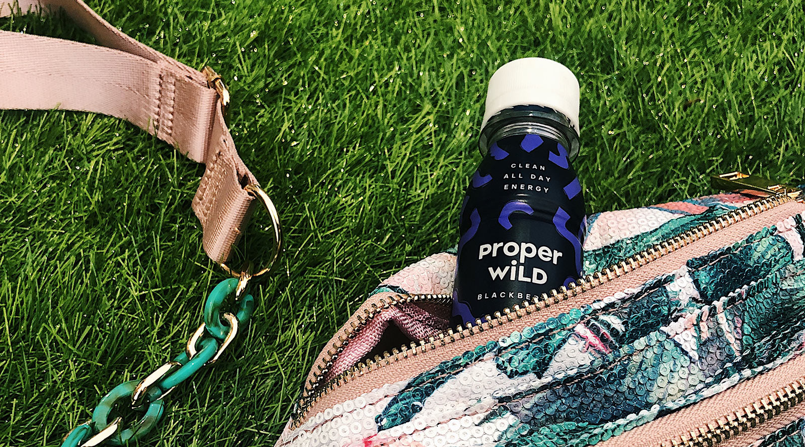 Proper Wild Bottles on grass in a fannypack