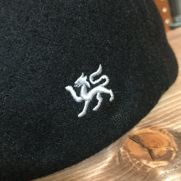 Detail of Griffin Embroidery view of Black Wool Flat Cap