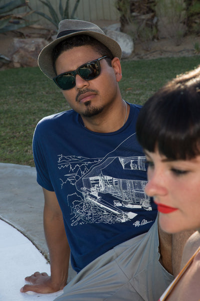 Mr. California wearing the Mountain House Case Study T-Shrit by the Pool with attractive woman.