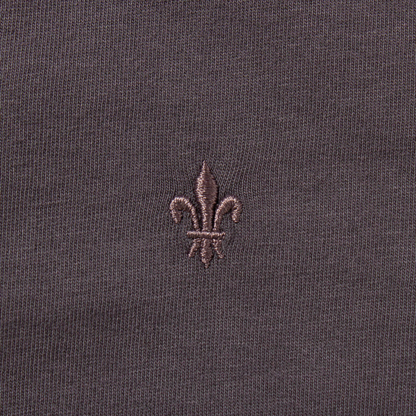 Dark grey colored undershirt embroidery detail.