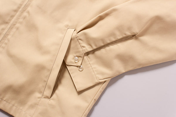 The Laguna Jacket in Sandstorm Tan - Outside Pocket Detail