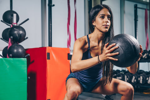 7 Things You Should Know Before Trying to Get Abs woman works out with pilates ball