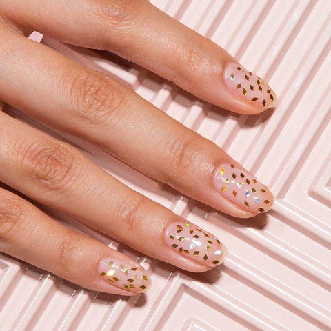 The Most Effortless Beauty Trends to Try in 2019 clear glitter nail art