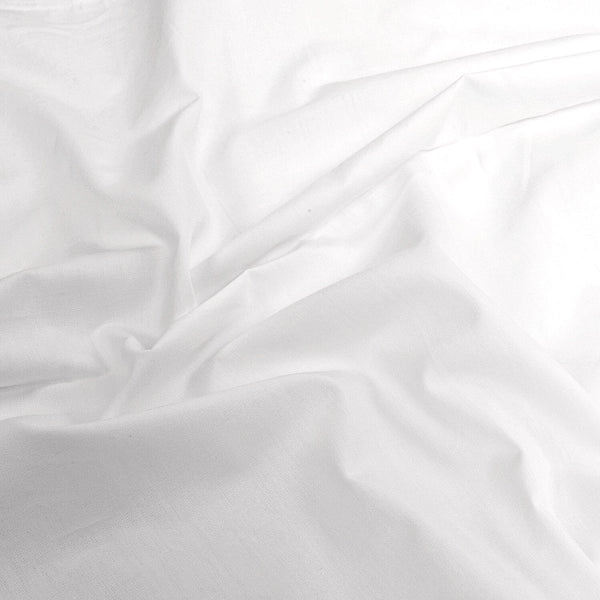 white cotton quilt covers