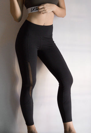 sport woman with abs wearing LXIX dri fit black mesh leggings with pockets in singapore