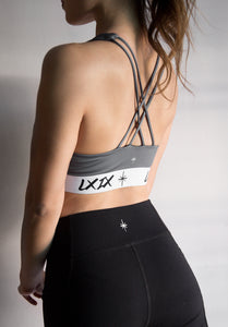 sport woman with abs wearing LXIX dri fit midnight gray sports bra and leggings in singapore