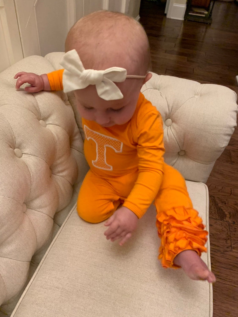 Baby girl in Power T Tennessee outfit