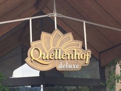 Sport - Wellness Resort Quellenhof Logo