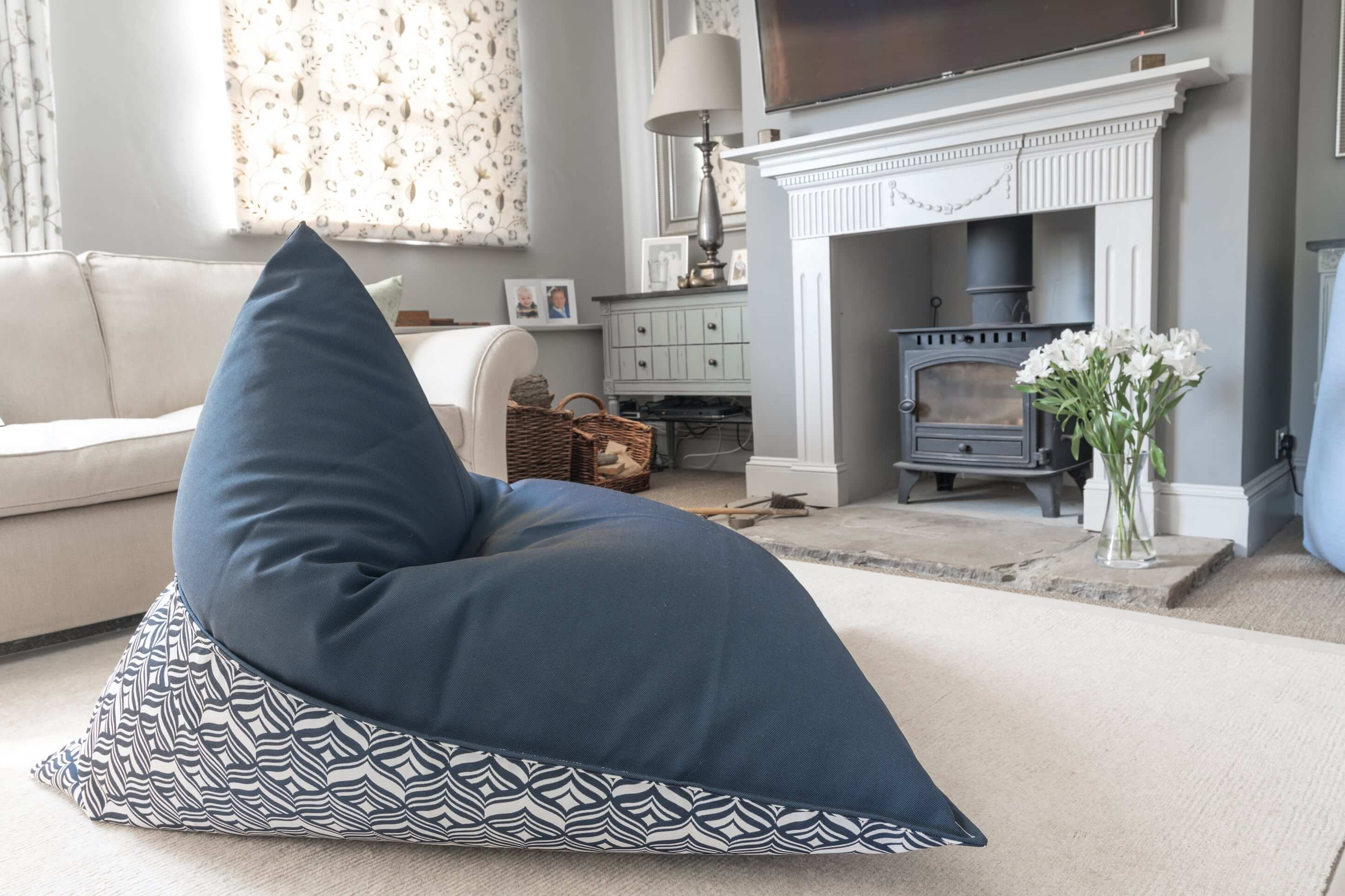 Navy blue bean bag with patterned detail adds luxury seating to a contemporary living rom