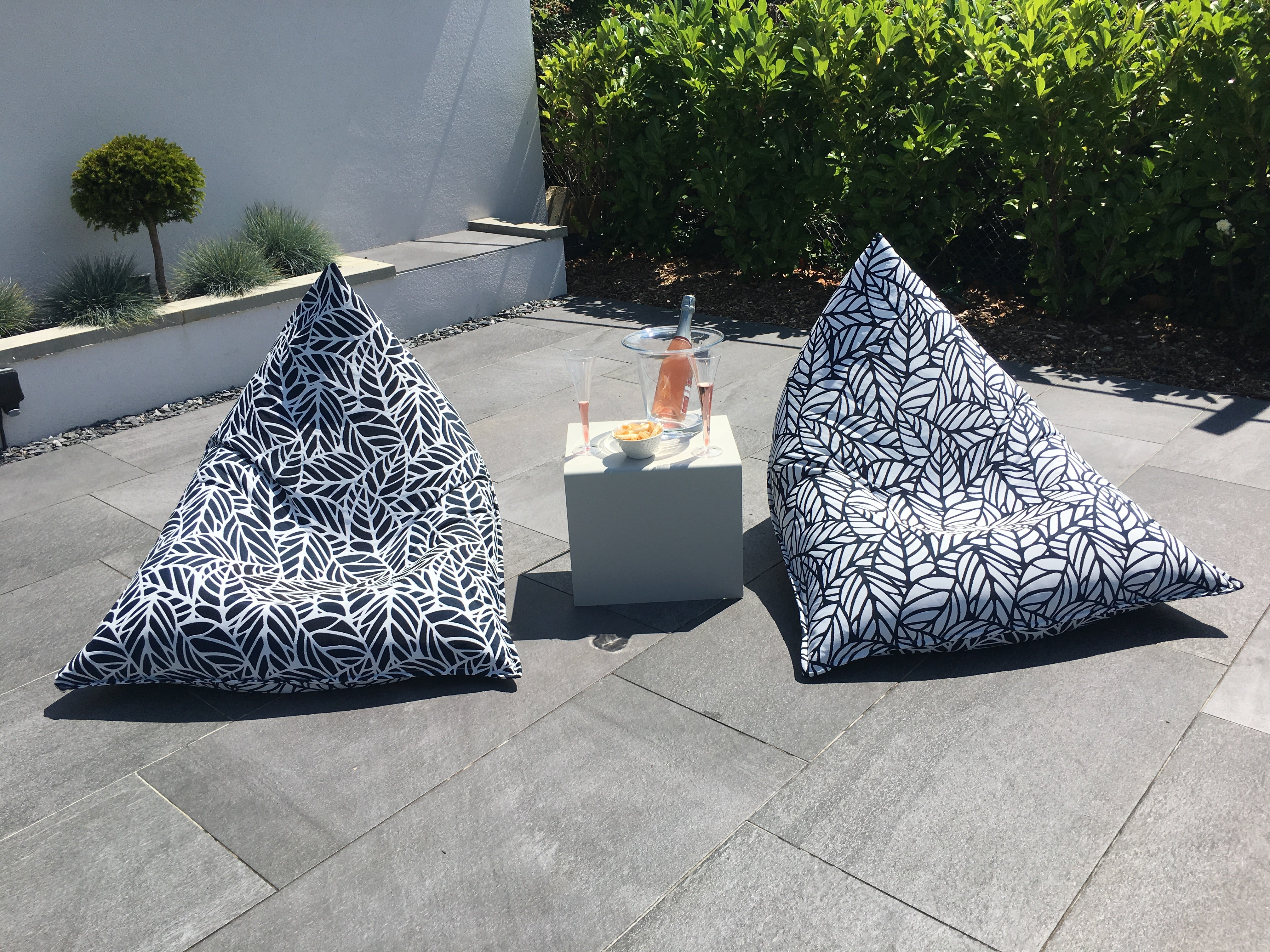 Custom monochrome bean bag chairs in a black and white palm pattern